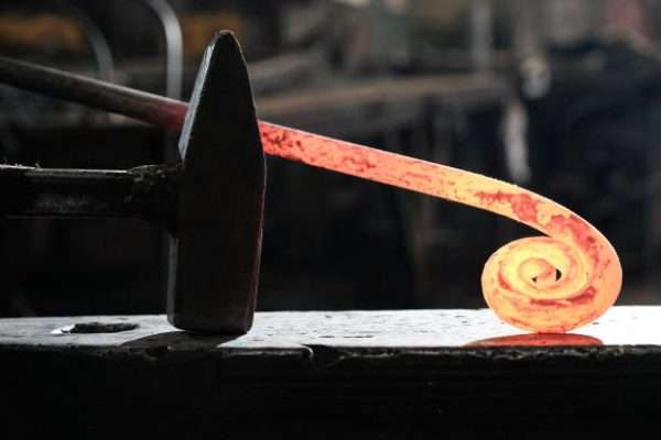 Blacksmith's workplace with horn fire hammer anvil metal