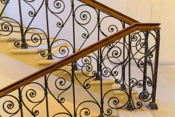 steps with handrails, forged staircase indoors